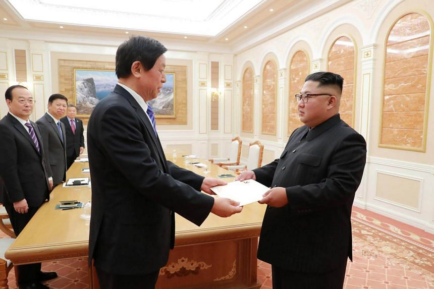 A photo released on Sept 10, 2018, showing North Korean leader Kim Jong Un (right) meeting with China's Li Zhanshu in Pyongyang, North Korea.