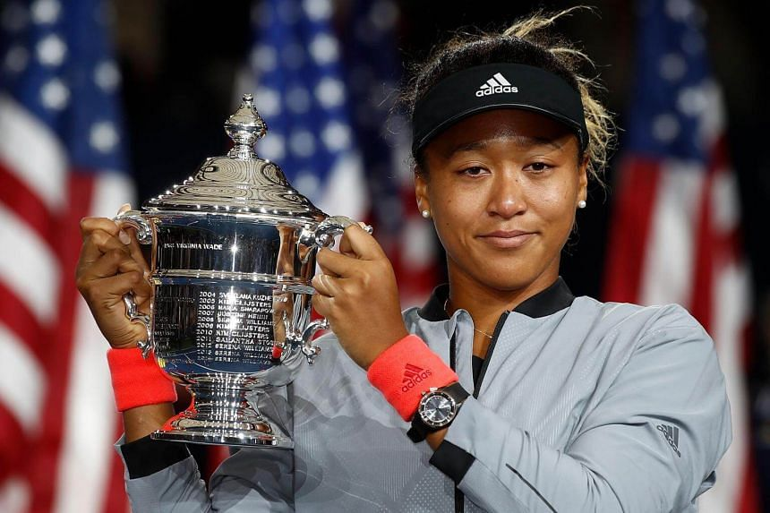 Naomi Osaka of Japan poses with the championship trophy after winning the Women's Singles finals match of the 2018 US Open at the USTA Billie Jean King National Tennis Center in New York, on Sept 8, 2018.
