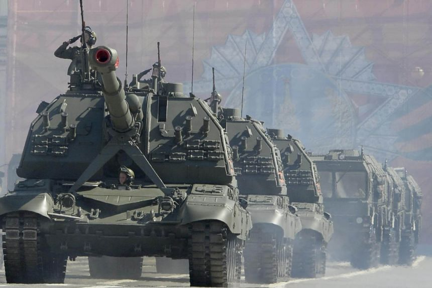 Russian Msta S artillery vehicles parade through Dvortsovaya Square during the Victory Day military parade in Saint Petersburg, on May 9, 2018.