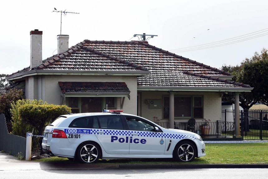 A police car is seen outside a house from where police recovered five dead bodies in the suburb of Australia's western city of Perth, on Sept 10, 2018.