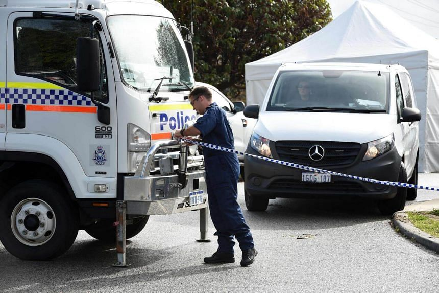 Police secure the area close to a house from where they recovered five dead bodies in the suburb of Perth, on Sept 10, 2018.
