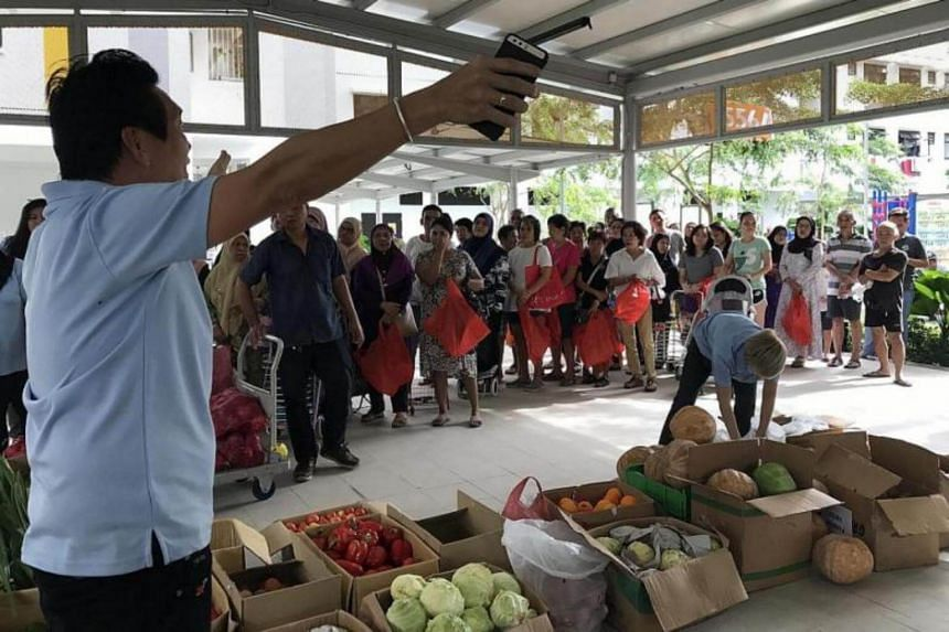 Food being distributed at a Food Bank Singapore event in Bedok. Food waste generated in Singapore has increased by 40 per cent in the last decade.