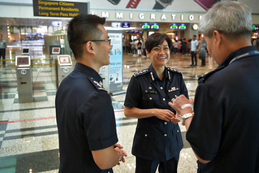 Senior Assistant Commissioner of Police (SAC) Zuraidah Abdullah (centre) speaking with ICA officers at the Changi Airport Terminal 3 on March 6, 2017.