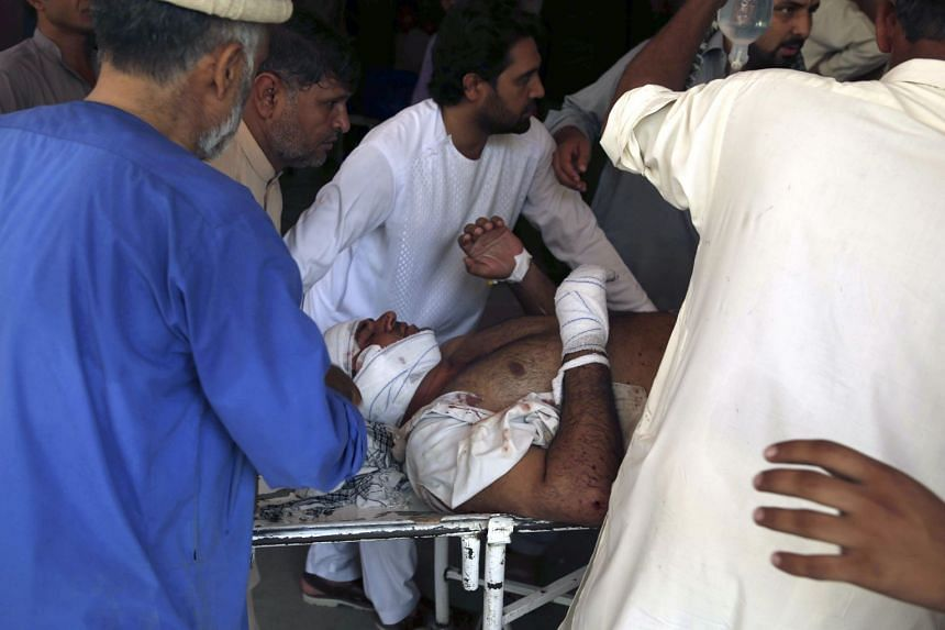A man injured in the attack receiving medical attention at a hospital in Jalalabad.