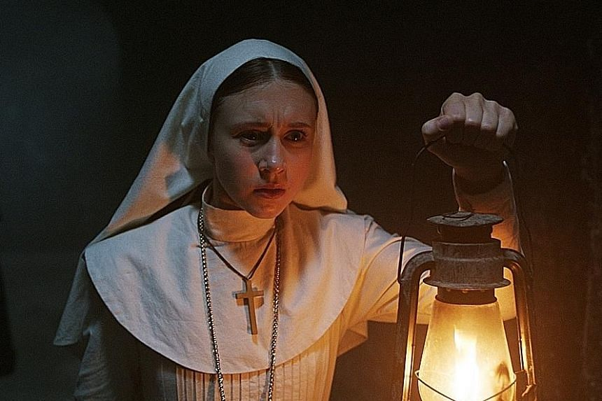 The Nun, starring Taissa Farmiga (above), took in $73.9 million for the three-day weekend at the box office in North America.