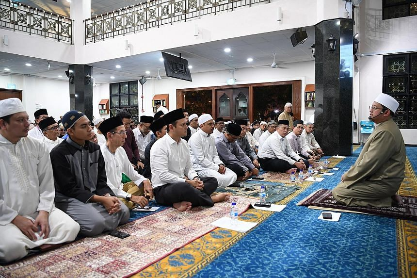Mufti Fatris Bakaram, Singapore's highest Islamic authority,giving a short sermon at the commemoration of the Islamic New Year held at Al-Khair Mosque yesterday, in line with the celebration's theme of Striving with Confidence, Serving with Compassi