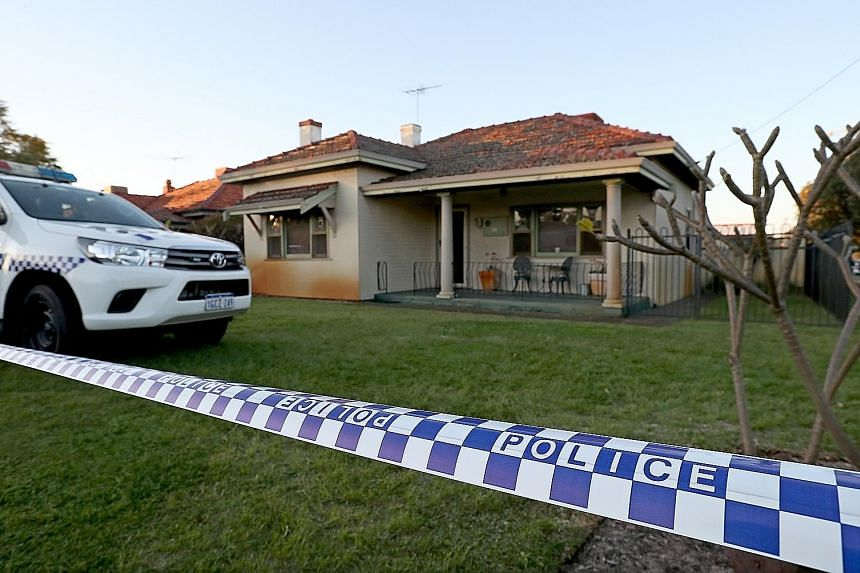 Police outside the family home in Perth on Sunday, where five bodies were found. The accused is said to have killed his wife, three toddlers and his mother-in-law over two days but turned himself in only a week later.