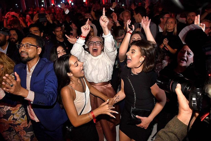 Supporters at the Social Democrats' election party in Stockholm on Sunday. The ruling party secured just 28.4 per cent of votes and 101 seats.