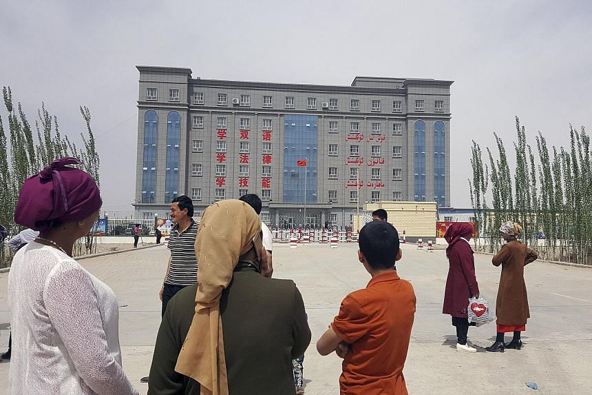 "A building on the edge of Hotan, a city in Xinjiang, is described by a sign as a ""concentrated transformation-through-education centre"". China told a UN panel last month that it does not operate re-education camps and described the facilities in ques"