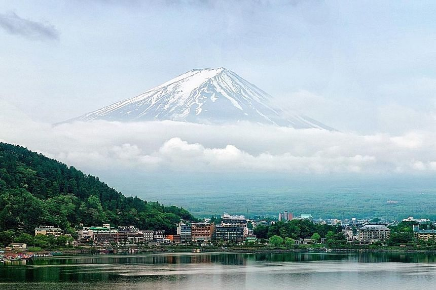 Japan's Mount Fuji was listed as a Unesco World Heritage Site on June 22, 2013. While it continues to draw tourists, experts say it is not necessary to take that overseas trip to enjoy the benefits of a vacation. Among the tips they give include taki