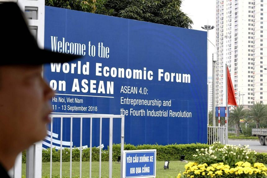 A Vietnamese security personnel guards the entrance of the National Convention Center in Hanoi, the venue of the World Economic Forum on Asean, on Sept 10, 2018.