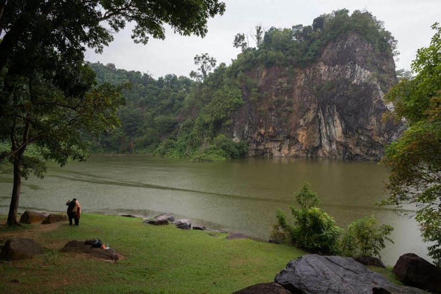 Two visitors to Little Guilin pose for a selfie in front of the iconic quarry. Little Guilin will soon be complemented by another new park in the Bukit Gombak area with the opening of the new Bukit Gombak Park in end-2019.