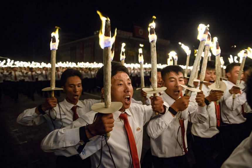 Participants perform in a torch parade on Kim Il Sung square in Pyongyang, on Sept 10, 2018.