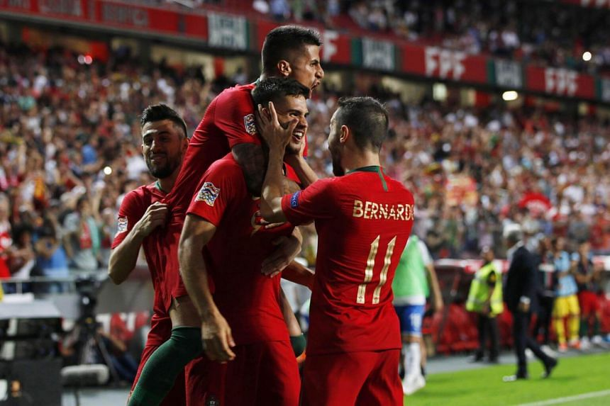 Portugal's Andre Silva (centre) celebrates with his teammates after scoring the 1-0 lead during the Uefa Nations League soccer match betwen Portugal and Italy in Lisbon, Portugal, on Sept 10, 2018.