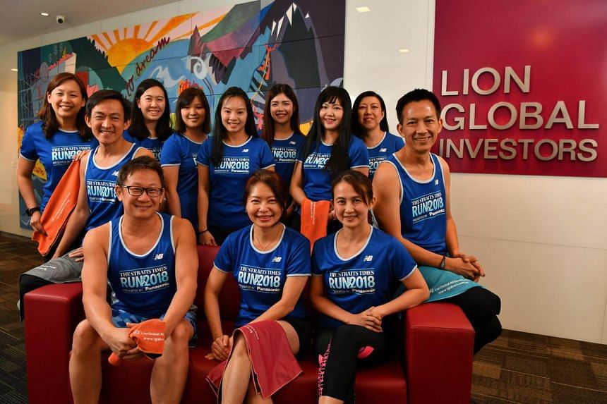 Staff of Lion Global Investor (LGI) who have signed up for the ST Run. Among them are LGI finance head Hazel Lee (seated, second from right), LGI chief marketing officer Lim Shyong Piau (seated, second from left, in spectacles) and LGI fund manager K