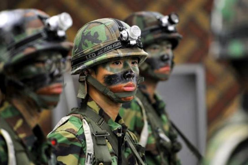 Nearly every able-bodied South Korean man is required to enrol by age 28 in the military, for a minimum of 21 months.