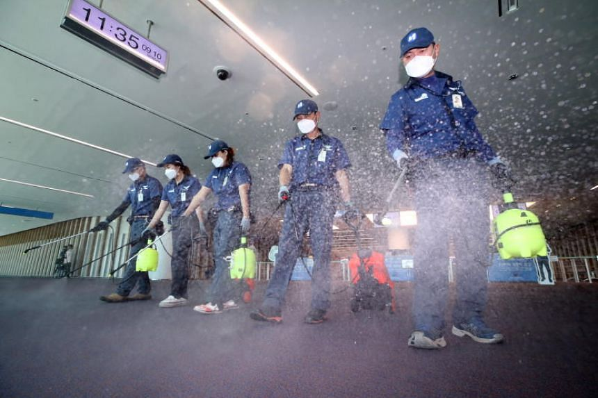 Sanitation workers disinfect the second terminal of Incheon airport, as part of efforts to stop the spread of Middle East Respiratory Syndrome (MERS), in Incheon, South Korea, on Sept 10, 2018.