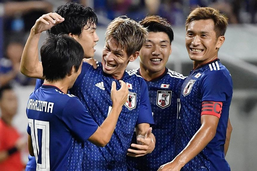 Japan's Sho Sasaki (centre) and his teammates celebrate their goal against Costa Rica during their international friendly soccer match in Suita, Japan, on Sept 11, 2018.