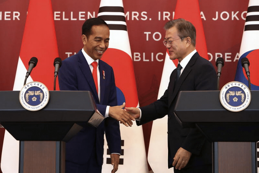 Indonesian President Joko Widodo (left) and South Korean President Moon Jae-in at a joint press conference in Seoul on Sept 10, 2018. Mr Joko is on a three-day tour of South Korea.