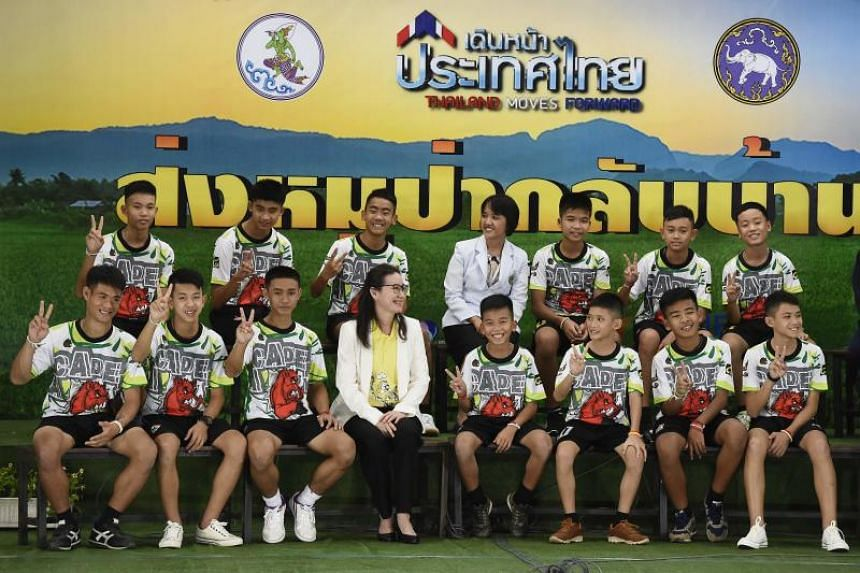 The Wild Boars football players and their coach attend a press conference in Chiang Rai, on July 18, 2018. Shooting for the movie The Cave, which tells the story of their rescue from a flooded cave, is planned for November 2018.
