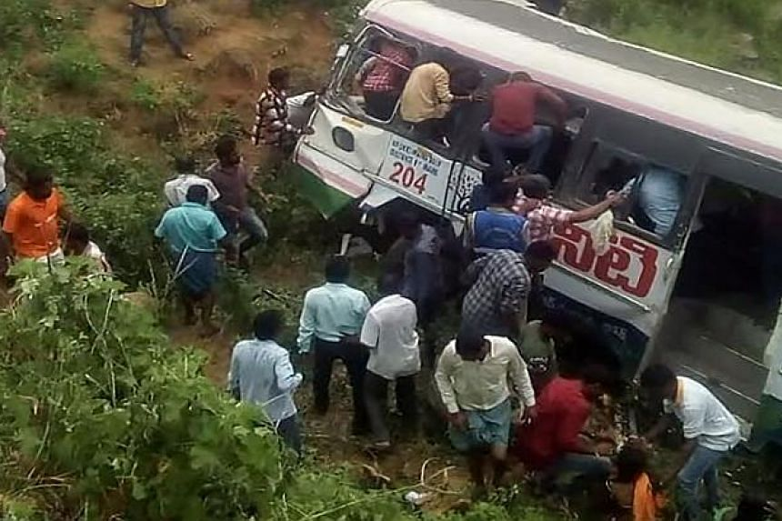 Onlookers and rescuers gathering around a bus that crashed in Jagtial district in Telangana state on Sept 11, 2018.