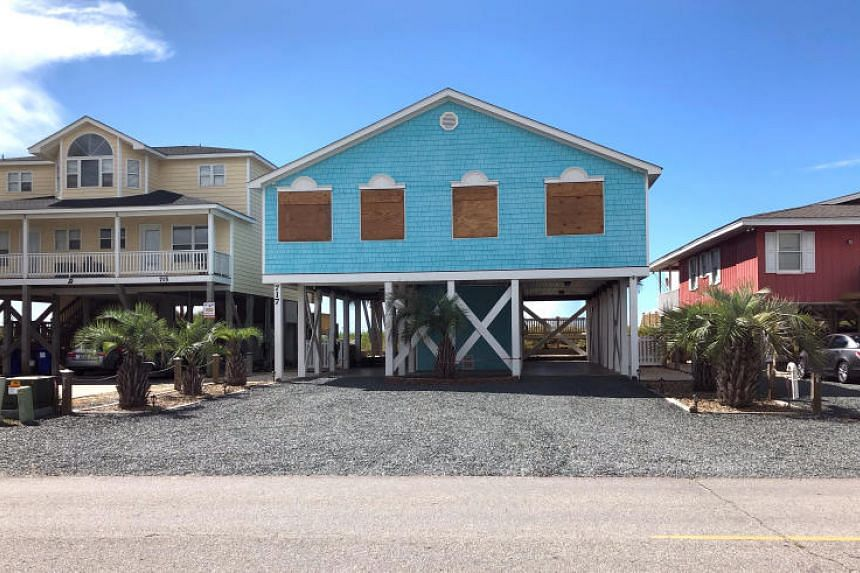Boarded up houses are seen ahead of Hurricane Florence's expected landfall, at Holden Beach, North Carolina, US, on Sept 10, 2018.