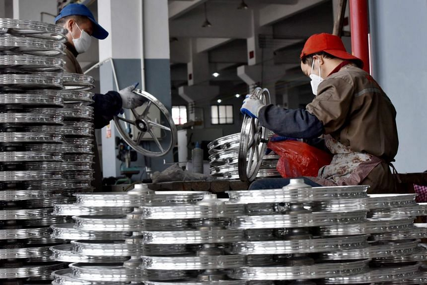 Employees working on bicycle parts at a factory in China's Zhejiang province. Chinese firms are evading US tariffs by shifting production to countries such as Vietnam and Mexico.