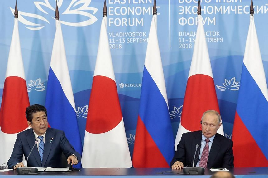 Japanese Prime Minister Shinzo Abe (left) and Russian President Vladimir Putin deliver their statements at a joint press conference following their talks in Vladivostok, Russia, on Sept 10, 2018