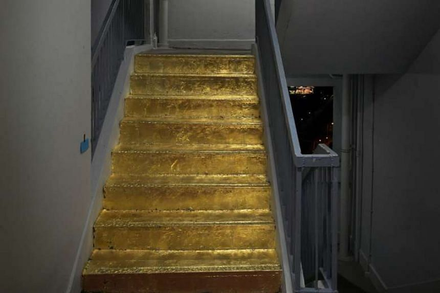 "The ""golden staircase"" on the 20th floor of Block 103, Jalan Rajah. Ms Dia's work earned her praise from netizens, but the Jalan Besar Town Council pointed out that it was not permissible under the council's by-laws."