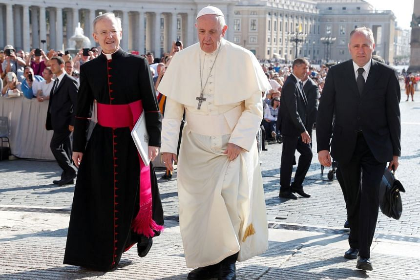 The Pope (centre) was accused of knowing for years about sexual misconduct by a cardinal and of doing nothing.