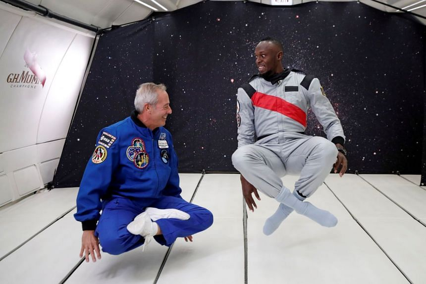 Bolt and French astronaut Jean-Francois Clervoy, chief executive of Novespace, enjoy zero gravity conditions.