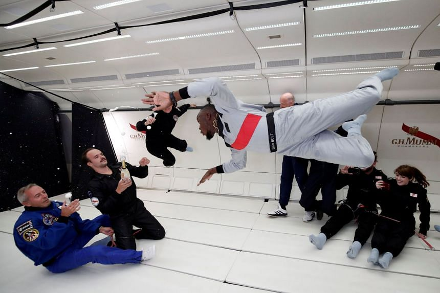 Bolt and company enjoy zero gravity conditions during a flight in a specially modified Airbus Zero-G plane.