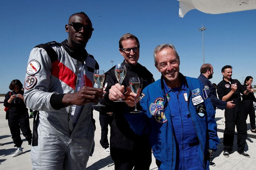 Bolt, French astronaut Jean-Francois Clervoy and Quentin Meurisse, or Martell Mumm Perrier-Jou't, after the flight.