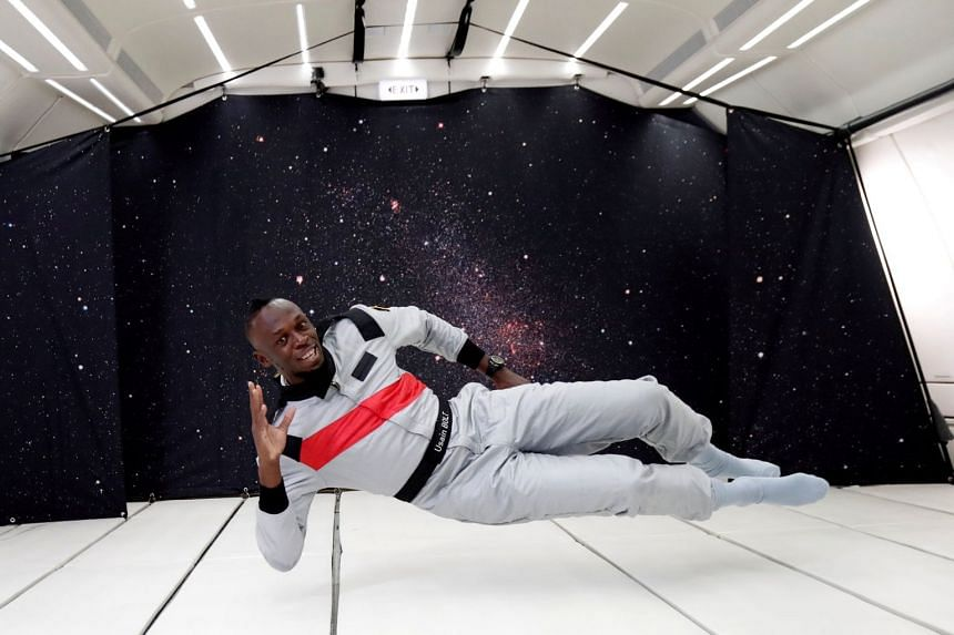 Bolt poses as he enjoys zero gravity conditions during a flight in a specially modified plane above Reims, France.