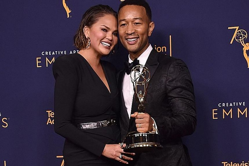 Singer John Legend and his wife, model Chrissy Teigen, at the Creative Arts Emmys ceremony on Sunday.