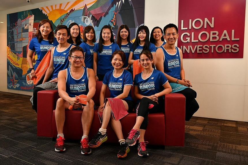 Some of the 31 employees of Lion Global Investors, the official fund house of The Straits Times Run 2018, who have signed up for the Sept 23 event. Its chief marketing officer Lim Shyong Piau (seated, second from left) will flag off the 5km runners a