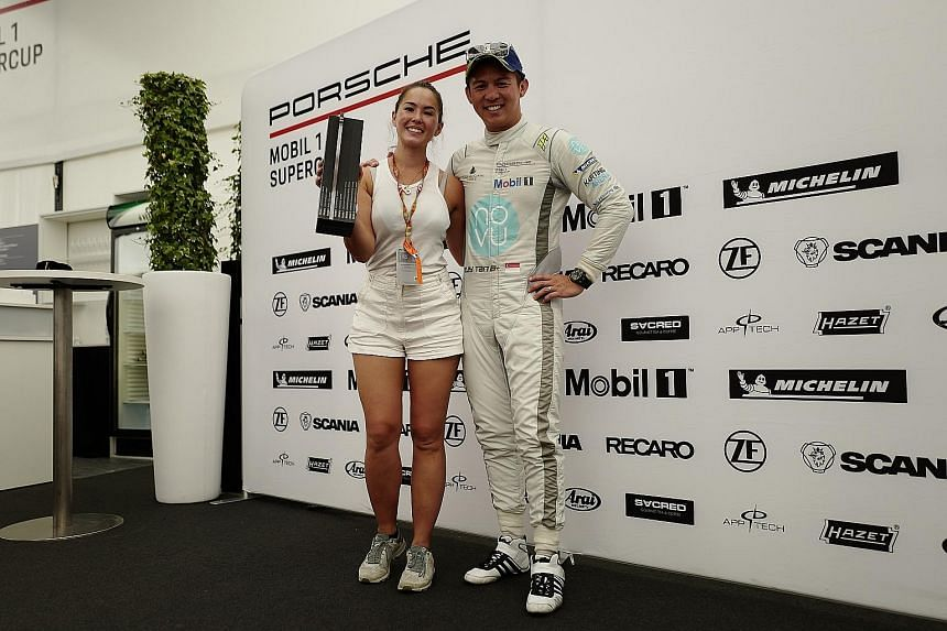 Singaporean race driver Yuey Tan and his wife Claire Jedrek at Silverstone after finishing third in the British leg of the Porsche Mobil 1 Supercup. Tan will compete in the Carrera Cup in Singapore this week.