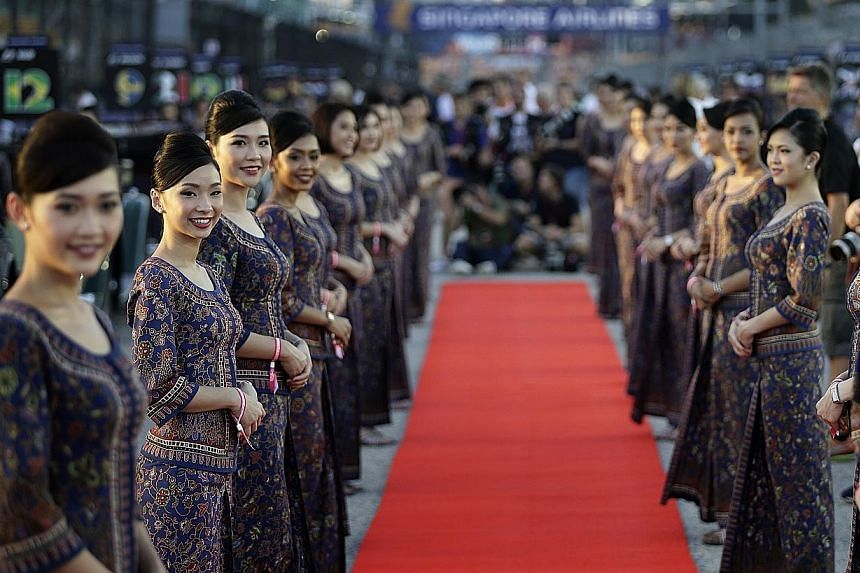 SIA's iconic sarong kebaya-clad staff at the 2016 Singapore Airlines Singapore Grand Prix. SIA yesterday confirmed they will appear at this year's race despite the F1 owner's ban on grid girls.