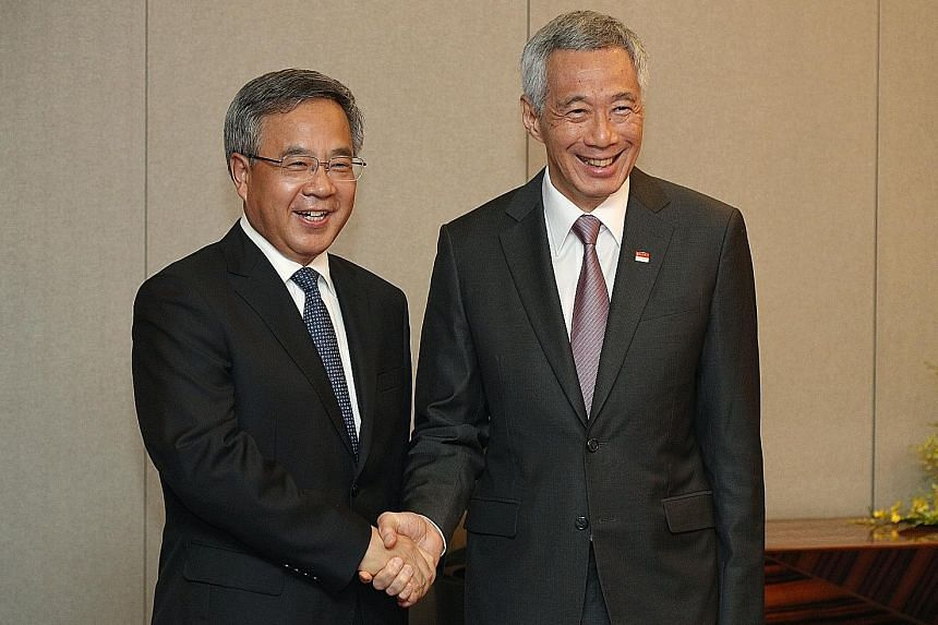 Prime Minister Lee Hsien Loong with Chinese Vice-Premier Hu Chunhua in Hanoi yesterday. They reaffirmed the strong economic cooperation between Singapore and China during their meeting.