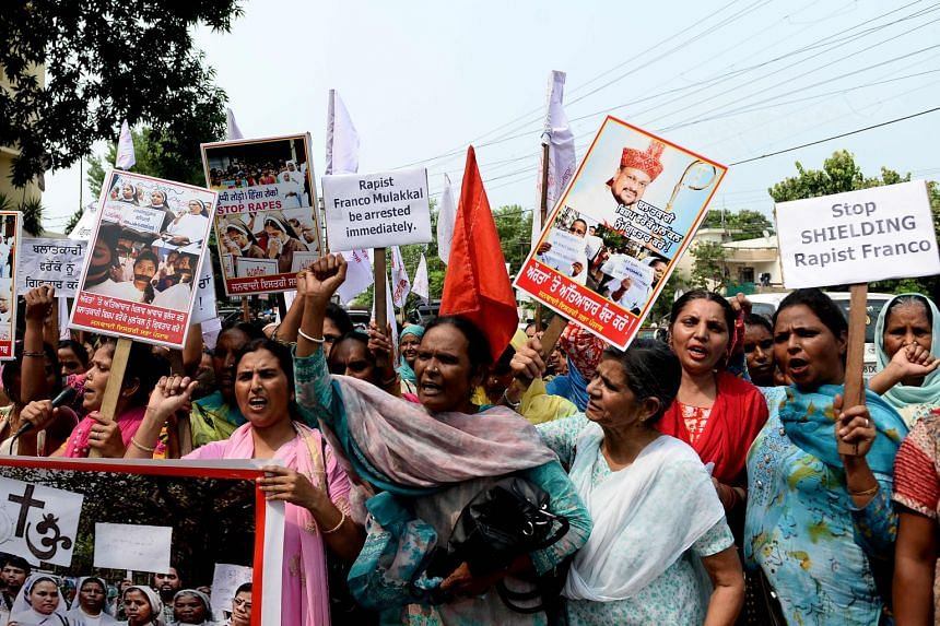 Indian women hold placards and chant slogans during a protest march to demand the immediate arrest of Bishop Franco Mullackal, who is accused of raping a nun, in Jalandhar, on Sept 12, 2018.