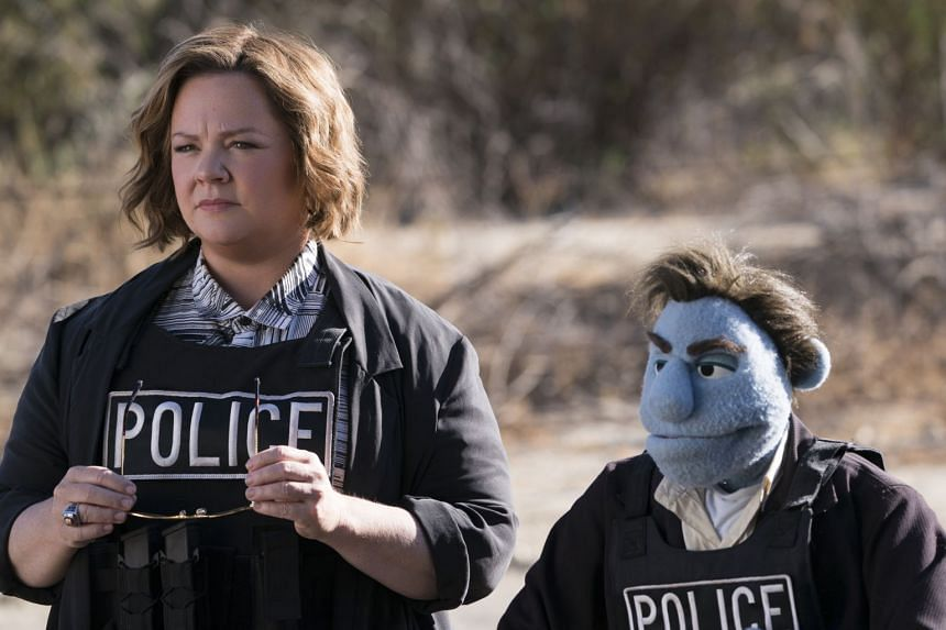 The Happytime Murders sees Melissa McCarthy (left) playing a police detective who teams up with a disgraced puppet ex-cop, Phil Phillips, to stop a serial killer.