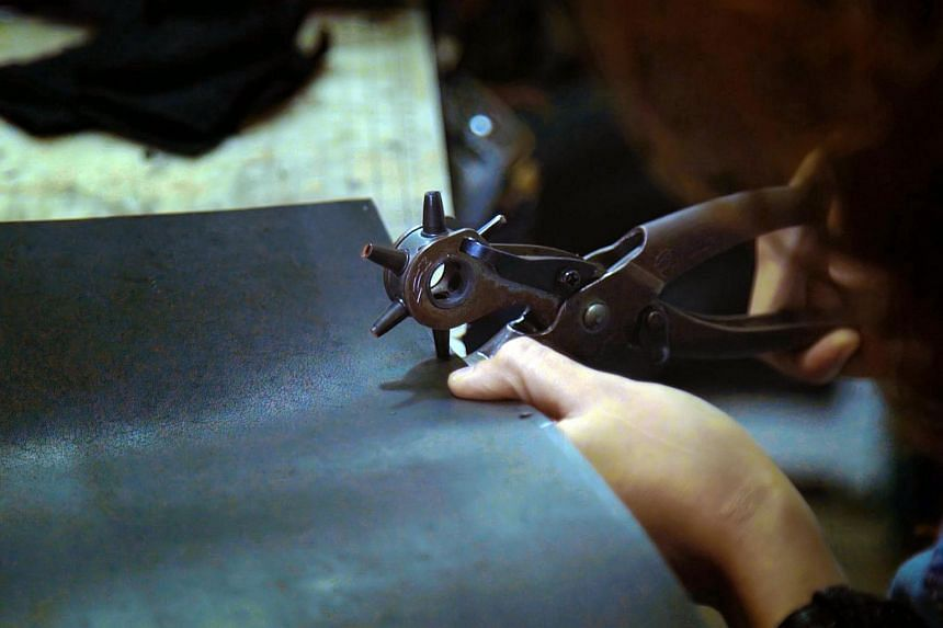 Ms Addynna works seven days a week in her studio in Race Course Road, painstakingly punching holes in leather and stitching it by hand. She does not own any machines and prefers to do it the traditional way.