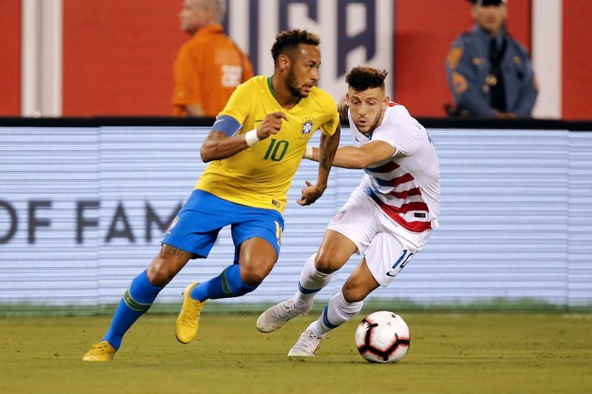Brazil's forward Neymar (left) vies for the ball with US midfielder Paul Arriola during their friendly match, on Sept 7, 2018.