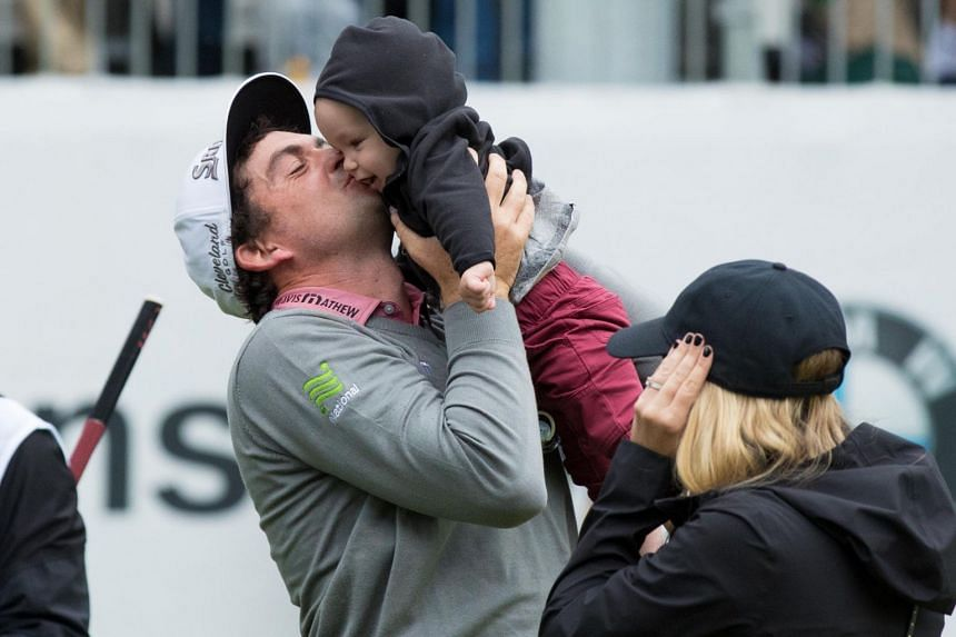 Keegan Bradley lands a kiss on his son Logan after pipping Justin Rose in a play-off to win the BMW Championship at Aronimink Golf Club in Philadelphia. Bradley's win on Monday ended a six-year barren run, while Rose's consolation was reaching the su