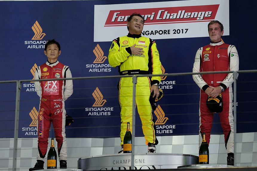 Singapore's Ringo Chong (centre) topping the podium at the Ferrari Challenge Asia-Pacific 2017 support race at the Marina Bay street circuit ahead of Malaysia's Zen Low and Italy's Angelo Negro.