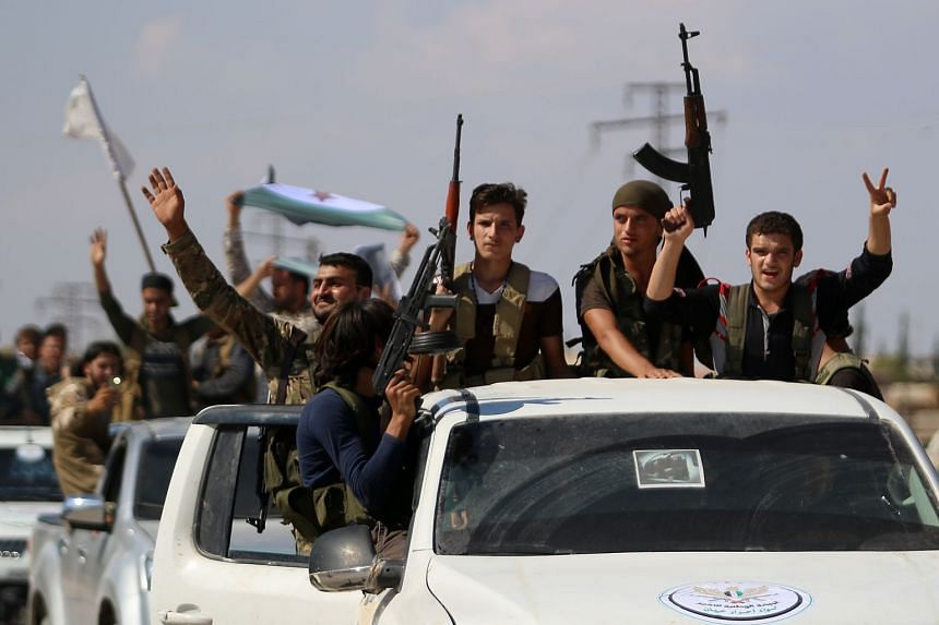 """Syrian rebel fighters from the recently-formed """"National Liberation Front"""" prepare for an upcoming government forces offensive."""
