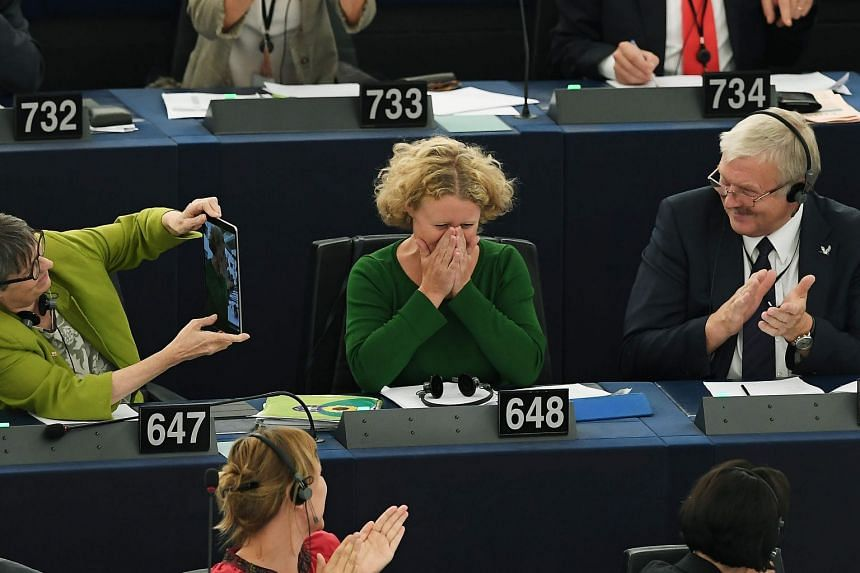 Judith Sargentini (centre) reacts after the vote on the situation in Hungary.