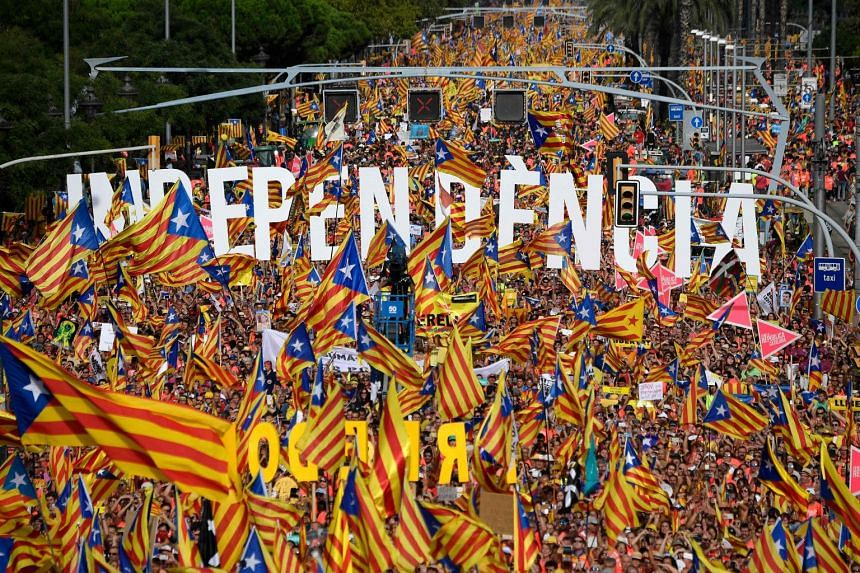 People wave pro-independence Catalan flags in Barcelona on Sept 11, 2018.