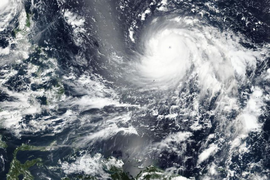 A satellite image acquired by the Visible Infrared Imaging Radiometer Suite on the Suomi NPP of Super Typhoon Mangkhut approaching Philippines, on Sept 11, 2018.