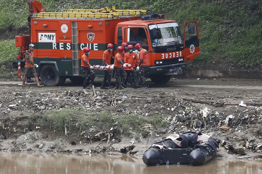 Filipino soldiers practice land and water rescue techniques along the banks of the Marikina River, east of Manila, on Sept 13, 2018.